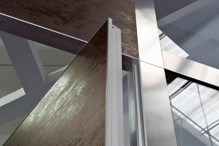 puerta pivotante detalle eje vertical